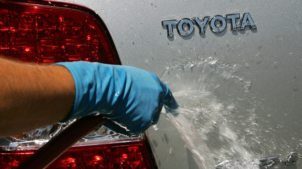 LOS ANGELES - APRIL 24:  An employee washes a customer's Toyota at the world's largest auto dealership, Longo Toyota, which enjoys continued strong sales after a record quarterly report for Toyota April 24, 2007 in El Monte, California. Japan-based Toyota has announced that it has overtaken American auto giant General Motors (GM) with worldwide sales reaching 2.35 million cars and trucks in the first quarter of 2007. GM announced its total for the same period was 2.26 million. As Toyota increased sales in every major market, GM gained market share in China but continued to struggle at home and in Europe and has never penetrated far into Japanese market. Toyota's achievement marks another milestone in the long decline of industrial dominance by U.S. car makers.  (Photo by David McNew/Getty Images)