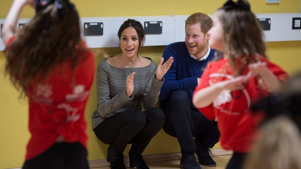 Meghan Markle and Prince Harry watch the Star Hub dancers.
