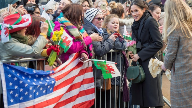 Meghan Markle greets American fans outside of Cardiff Castle.