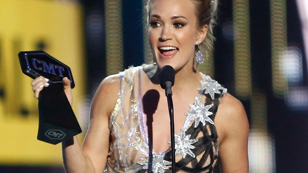 "Carrie Underwood accepts the award for female video of the year for ""Church Bells"" at the CMT Music Awards at Music City Center on Wednesday, June 7, 2017, in Nashville, Tenn."