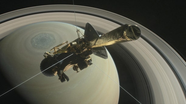 File photo: The spacecraft Cassini is pictured above Saturn's northern hemisphere prior to making one of its Grand Finale dives in this NASA handout illustration obtained by Reuters August 29, 2017. (NASA/Handout via REUTERS)