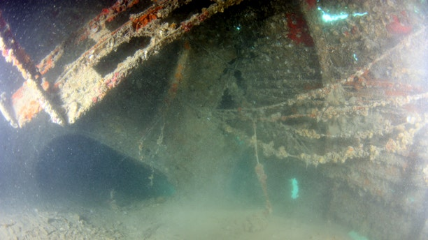 Silted interior of the fuselage in the area of the mechanic's compartment. (Credit UH Marine Option Program)