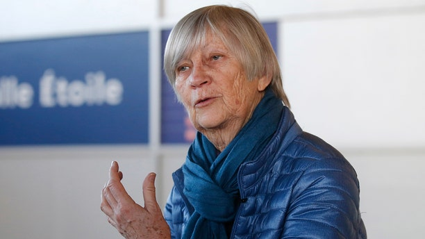 Catherine Bonnet, French child psychiatrist and a member of the Pontifical Commission for the Protection of Minors, gestures as she speaks during an interview with the Associated Press at Charles de Gaulle airport outside Paris, France, Sunday, Feb. 4, 2018.