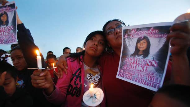 May 4, 2016: Klandre Willie, left, and her mother, Jaycelyn Blackie, participate in a candlelight vigil for Ashlynne Mike at the San Juan Chapter House in Lower Fruitland, N.M. The FBI said Ashlynne was abducted after school and her body was found the next day. The death of the young Navajo Nation girl is fueling efforts to create an Amber Alert plan on the vast reservation.