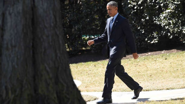 President Obama walks towards Marine One on the South Lawn of the White House, on March 12, 2015.