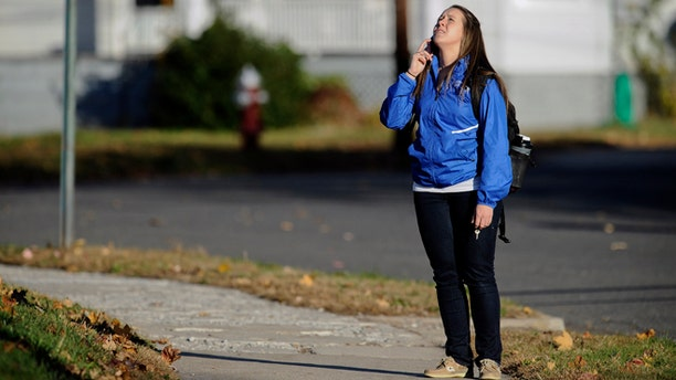 Nov. 4, 2013: A student waits to return to campus following a lockdown due to a sighting of an armed man at Central Connecticut State University in New Britain, Conn.