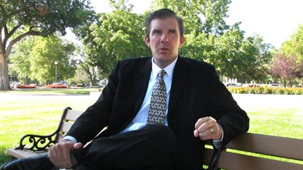 Aug. 13, 2014: Chad Taylor discusses his campaign during an interview on the Statehouse grounds in Topeka, Kan.