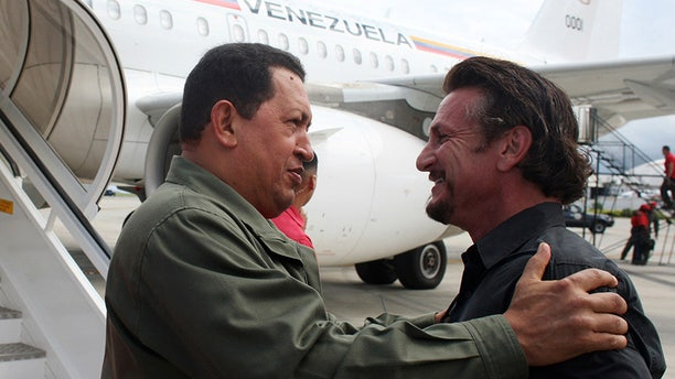 Venezuela's President Hugo Chavez (L) talks with U.S. actor and director Sean Penn in Cumana, 400 km (249 miles) east of Caracas October 19, 2008. Penn accompanied Chavez on a visit to a Venezuelan Petroleum (PDVSA) company gas plant. REUTERS/Miraflores Palace/Handout (VENEZUELA) - RTX9Q5P