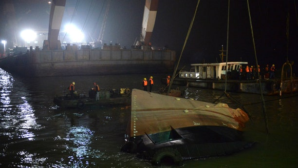 Jan. 16, 2015:  Rescuers salvage the wreck after a tug boat sank in the Yangtze River in east China's Jiangsu Province.