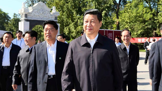 Sept. 15, 2012: In this photo released by Xinhua News Agency, Chinese Vice President Xi Jinping, center, attends an activity to mark this year's National Science Popularization Day at China Agricultural University in Beijing.