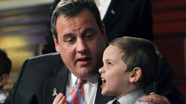 New Jersey Gov. Chris Christie listens Wednesday, April 6, 2011, in Trenton, N.J., to now 5-year-old Jesse Koczon after Christie signed a proclamation making Jesse the state's honorary governor for the day. (AP Photo/Mel Evans)