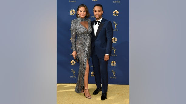 Chrissy Teigen and John Legend attended the 70th annual Emmy awards where the model was caught making one of her infamous famous on camera yet again.