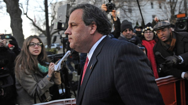 Jan 9, 2014: New Jersey Gov. Chris Christie walks past reporters as he leaves City Hall in Fort Lee, N.J.