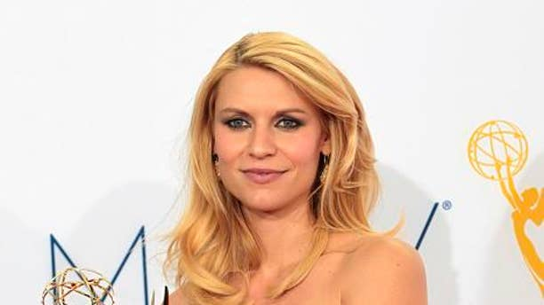 """Actress Claire Danes wins Best Actress Emmy for """"Homeland"""" at the 64th Primetime Emmy Awards in Los Angeles September 23, 2012."""