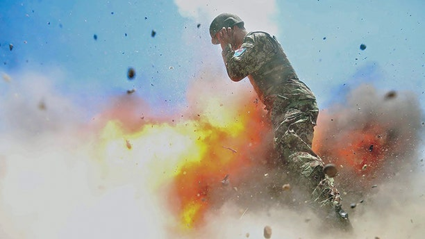 A mortar tube accidentally explodes during an Afghan National Army live-fire training exercise in Laghman province, Afghanistan, July 2, 2013. This photo was taken by U.S. Army Spc. Hilda Clayton, who died in the blast.
