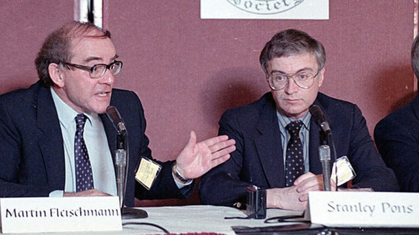 Martin Fleischmann, left, of the University of Southampton, England, talks to reporters about cold fusion as University of Utah chemist B. Stanley Pons listens, in Los Angeles, May 9, 1989. The pair of scientists claimed they have achieved nuclear fusion at room temperature.