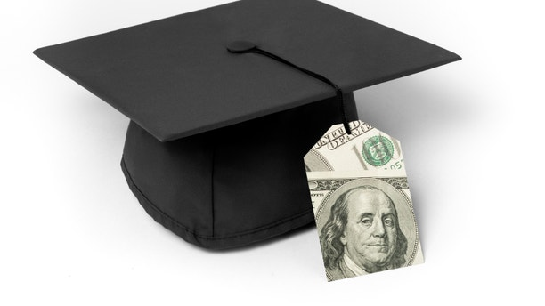 Mortarboard with 100 dollar bills price tag as a tassle on a white background