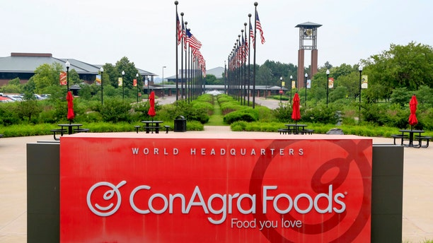 FILE - In this Tuesday, June 30, 2015, file photo, flags fly over ConAgra Foods world headquarters in Omaha, Neb.  Nearly a decade after hundreds of Americans got sick after eating Peter Pan peanut butter tainted with salmonella, ConAgra Foods appears close to settling a federal criminal case stemming from the outbreak. Federal prosecutors announced last year that Chicago-based ConAgra had agreed to pay $11.2 million, a sum that includes the highest fine ever in a U.S. food safety case,and plead guilty to a single misdemeanor charge in the 2007 outbreak.  (AP Photo/Nati Harnik, File)