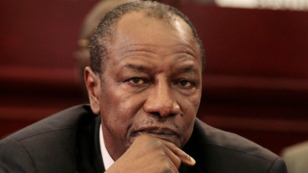 July 1, 2011: Guinean President Alpha Conde looks on during the closing session of the 17th African Union Summit, at Sipopo Conference Center, outside Malabo, Equatorial Guinea. Guinea's democratically elected president survived an assassination attempt early Tuesday when gunmen descended on his home, an attack that throws into doubt the political stability of this country with a history of coups and military rule.