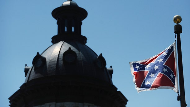 June 19, 2015: The Confederate flag flies near the South Carolina Statehouse, in Columbia, S.C.