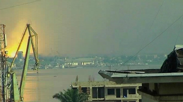 March 4: This video image taken across the Congo river in Kinshasa, Congo shows a blast that rocked Brazzaville the capital of the Republic of Congo.