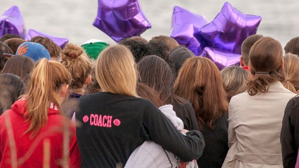 Apr. 25, 2014: People gather at the beach for a vigil in honor of murdered student Maren Sanchez in Milford, Connecticut.