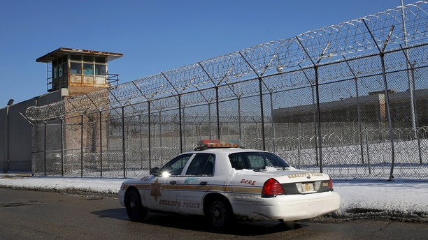 A Cook County Sheriff's police car patrols the exterior of the Cook County Jail in Chicago, Illinois, January 12, 2016. The Cook County Jail in Chicago -- the biggest single-site jail in the United States -- was placed on lockdown on Tuesday after staffing dropped below normal levels, said Cook County Sheriff's spokesman Ben Breit. REUTERS/Jim Young - RTX22355