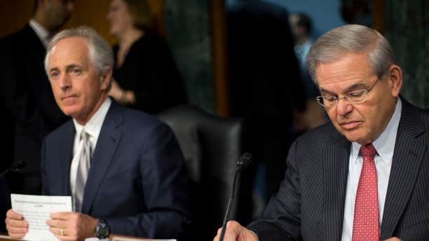 March 11, 2015: Senate Foreign Relations Committee Chairman Sen. Bob Corker, R-Tenn., left, and the committee's ranking member, Sen. Robert Menendez, D-NJ., prepare for the committee's hearing on Capitol Hill in Washington.