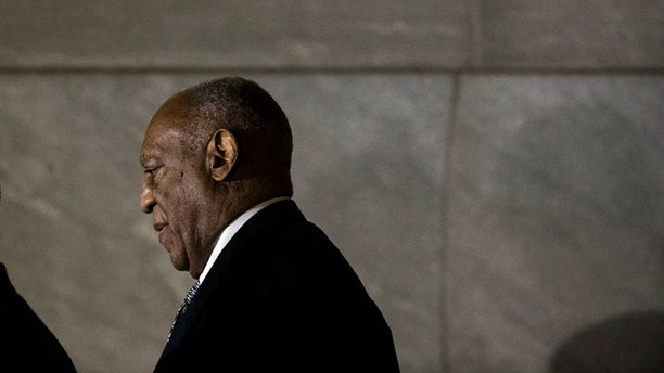 Bill Cosby walks from the Montgomery County Courthouse during his sexual assault trial.