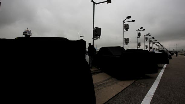 JOLIET, IL - SEPTEMBER 12: Trucks sit covered in the rain during qualifying for the NASCAR Camping World Truck Series Lucas Oil 225 at Chicagoland Speedway on September 12, 2014 in Joliet, Illinois. (Photo by Nick Laham/Getty Images)