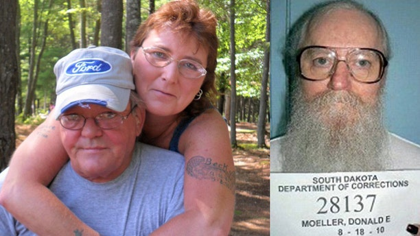 Tina Curl, shown hugging husband Dave Curl, plans to travel to South Dakota to witness the execution of Donald Moeller, who killed her daughter. (AP)