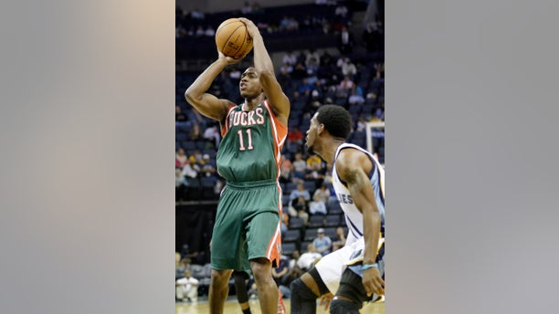 Milwaukee Bucks' Brandon Knight (11) shoots in front of Memphis Grizzlies' Mike Conley during the first half of an NBA preseason basketball game in Memphis, Tenn., Tuesday, Oct. 15, 2013. The Grizzlies won 102-99. (AP Photo/Danny Johnston)