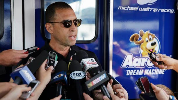 Team owner Rob Kauffman speaks to the media during a practice session for Sunday's NASCAR Pocono 400 auto race, Saturday, Aug. 1, 2015, in Long Pond, Pa. (AP Photo/Matt Slocum)