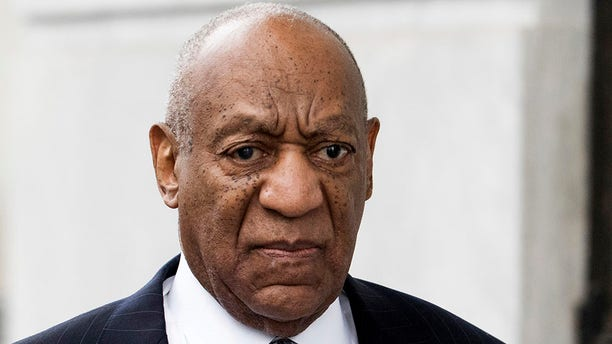 In this April 4, 2018, file photo, Bill Cosby arrives at the Montgomery County Courthouse in Norristown, Pa. Cosby's lawyers are challenging the legality of the process under which a Pennsylvania board recommended he be classified as a sexually violent predator. They also claimed in a court filing that the state's recently revised sex offender registry law is unconstitutional and should not be applied retroactively.