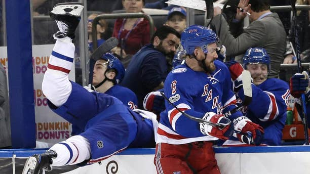 New York Rangers' Kevin Klein, right, checks Montreal Canadiens' Torrey Mitchell over the boards during the third period in Game 3 of an NHL hockey first-round playoff series, Sunday, April 16, 2017, in New York. The Canadiens defeated the Rangers 3-1. (AP Photo/Seth Wenig)