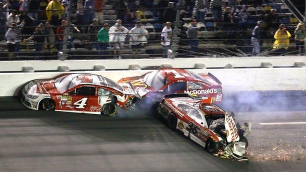 Kevin Harvick (4), Jamie McMurray (1) and Reed Sorenson (36) crash on the front stretch on the last lap of the Daytona 500 NASCAR Sprint Cup Series auto race at Daytona International Speedway in Daytona Beach, Fla., Sunday, Feb. 23, 2014. (AP Photo/John Raoux)