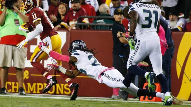 Seattle Seahawks cornerback Richard Sherman (25) misses the tackle as Washington Redskins wide receiver DeSean Jackson (11) runs for a touchdown during the first half of an NFL football game in Landover, Md., Monday, Oct. 6, 2014. (AP Photo/Alex Brandon)