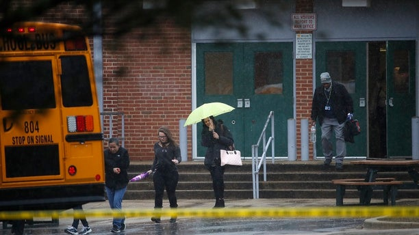 Students leave the scene of an incident at Great Mills High School on Tuesday, March 20, 2018.