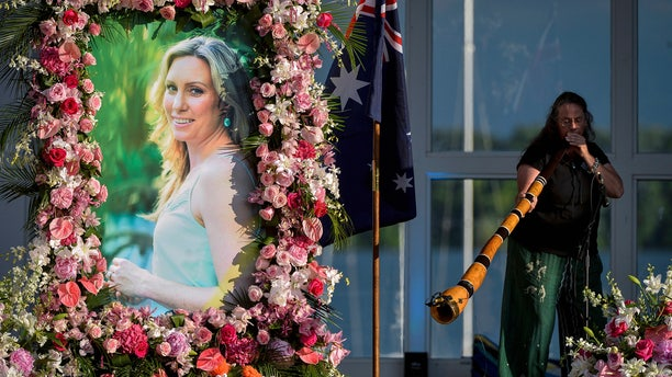 Johanna Morrow plays the didgeridoo during a memorial service for Justine Damond in Minneapolis