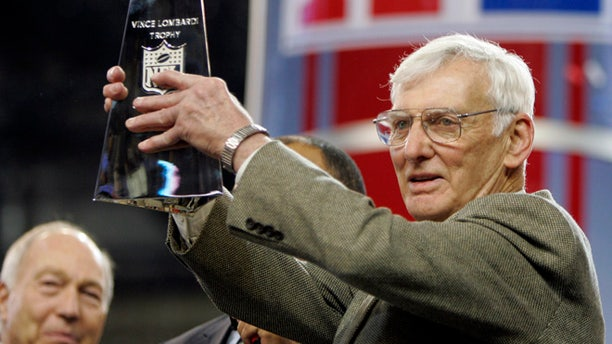 Dan Rooney, right, holding up the Vince Lombardi Trophy in 2006.