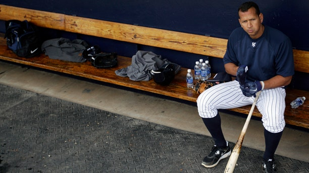 Feb. 25, 2012: New York Yankees' Alex Rodriguez sits in the dugout during practice at baseball spring training in Tampa, Fla.  (AP/Matt Slocum, File)