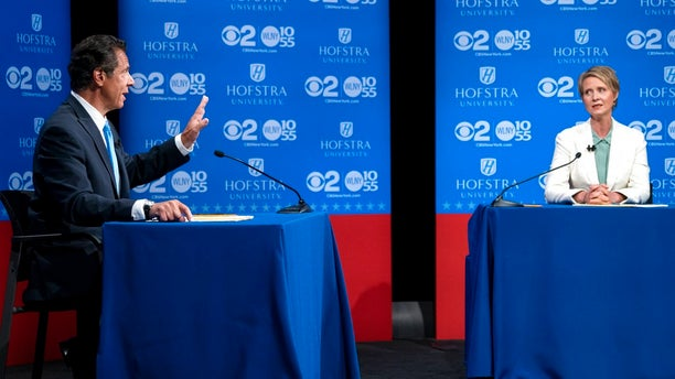Cuomo answers a question at a debate last month as Cynthia Nixon looks on.