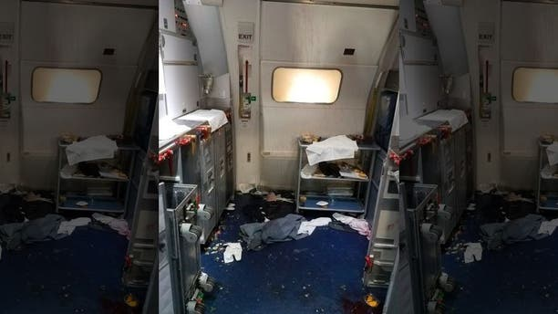 This Friday, July 7, 2017 photo taken the FBI and released via the U.S. Attorney's Office in Seattle shows the aftermath of a cabin on Delta Flight 129 from Seattle to Beijing.