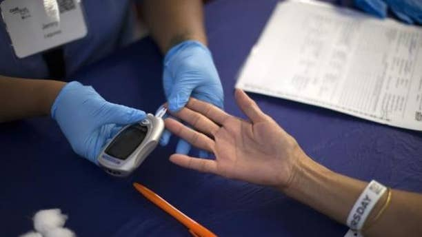 Sept. 11, 2014: A person receives a test for diabetes during Care Harbor LA free medical clinic in Los Angeles, California.