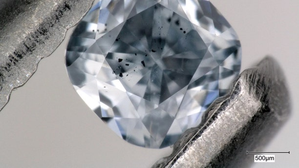 The dark specks trapped inside rare blue diamonds like these contain valuable secrets about Earth's inner life. In a new study, scientists took an intimate look at 46 of the most expensive gems on Earth. Credit: Evan M. Smith/Copyright 2018 GIA