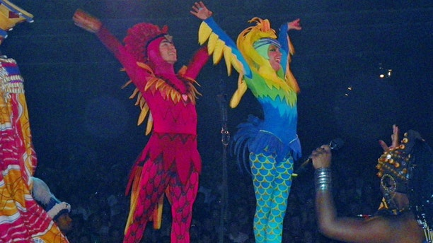 Crowder, right, claims that was unjustly terminated as an aerial performer in the Festival of the Lion King show at Disney's Animal Kingdom Park after her maternity leave.