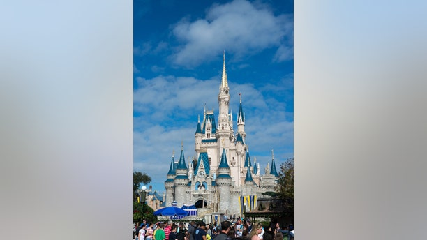 Orlando, Florida, USA. December 27,2014. Sunny day with Cinderella's Castle at Walt Disney World. Picture was taken on one of the busiest days of the year as evidenced by the crowd of people in front of the castle.