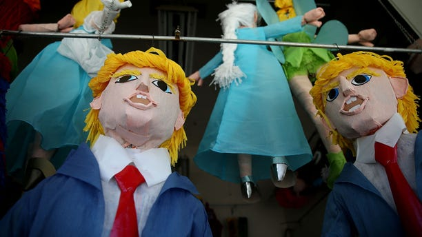 SAN FRANCISCO, CA - AUGUST 28:  Donald Trump pinatas are displayed in the window at Pinata Art on August 28, 2015 in San Francisco, California.   (Photo by Justin Sullivan/Getty Images)