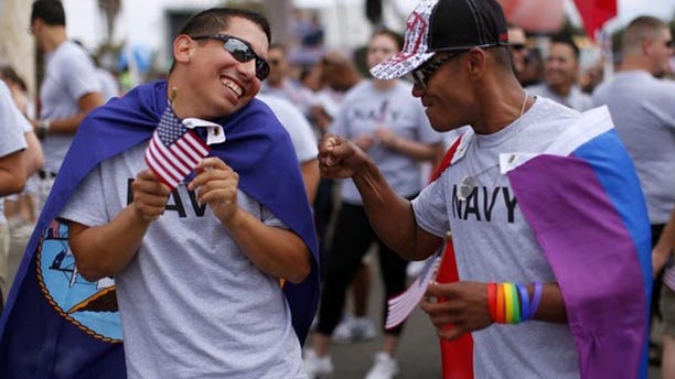 Active and retired military servicemen prepare to march in the Gay Pride Parade.