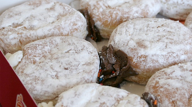 Dunkin' Donuts said Thursday it has agreed to remove titanium dioxide.